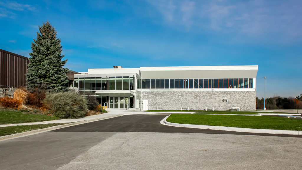 Exterior photo of the building entrance and landscape
