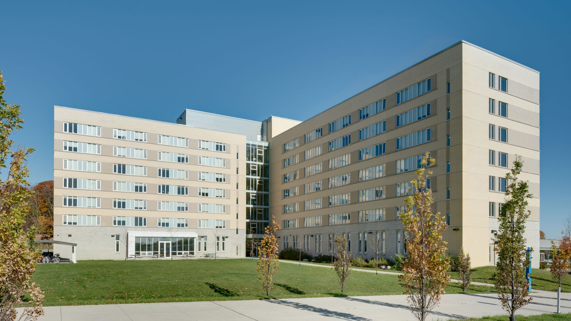 Exterior photo of the Student Residence building with a front lawn