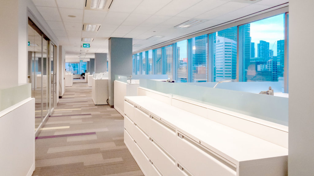 Interior photo of the office space with and file cabinets