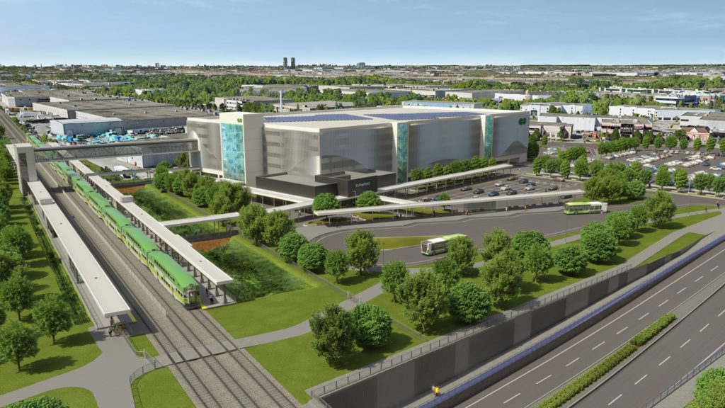 Exterior rendering of the facility showing the parking garage, bus terminal, rail platforms and the underpass