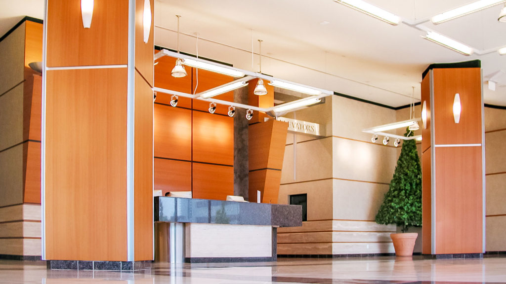 Interior photo of the lobby showing the front desk and lighting fixtures